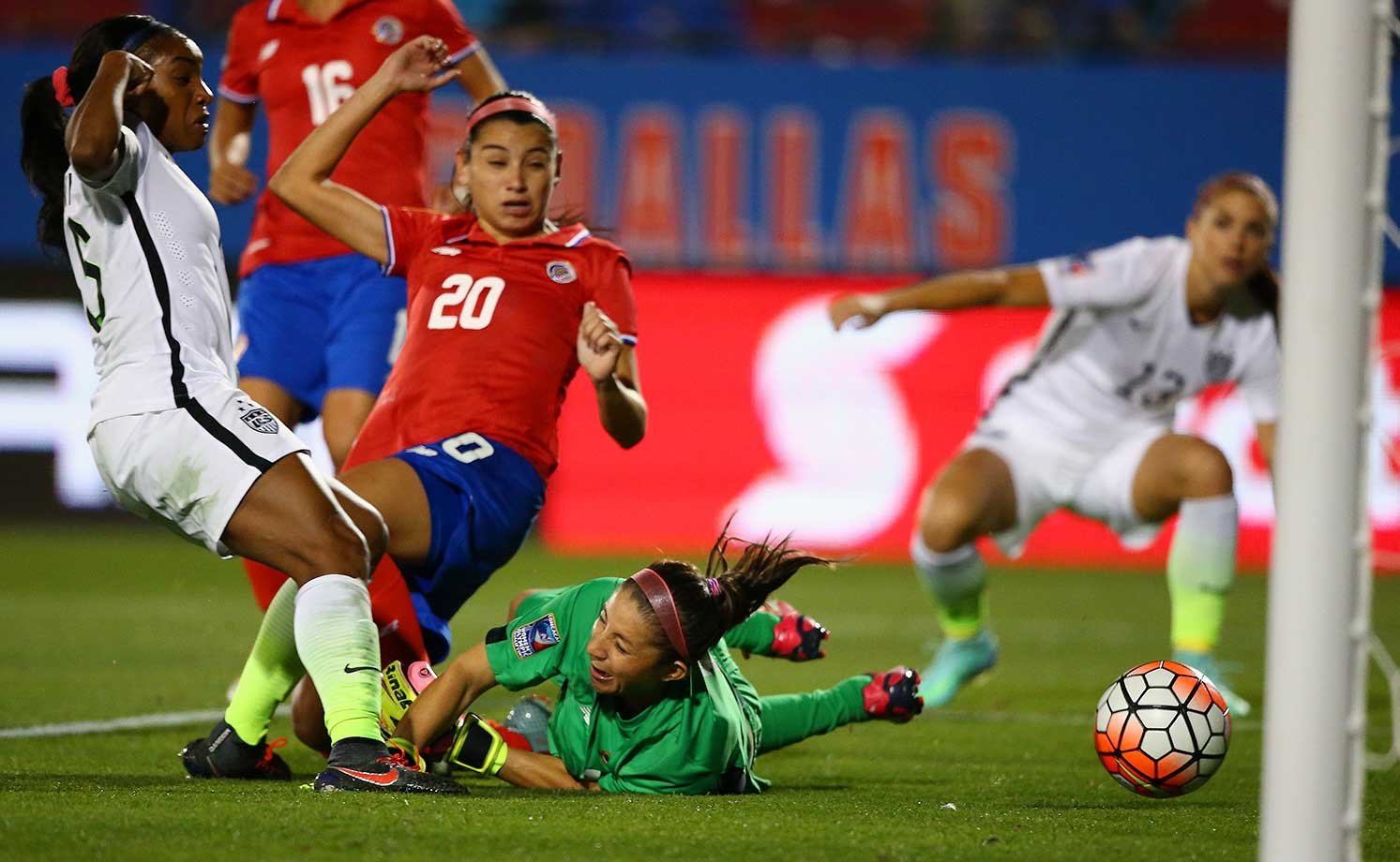 Crystal Dunn scores a goal past Dinnia Diaz of Costa Rica during CONCACAF Olympic Qualifying in Frisco, Texas.