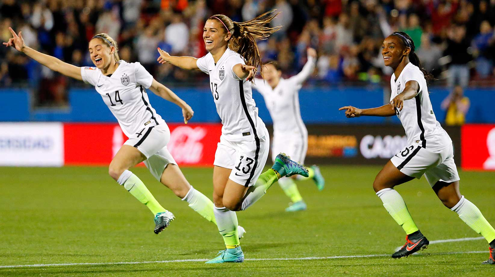 Alex Morgan (13), Morgan Brian (14) and Crystal Dunn, right, celebrate a goal by Morgan against Costa Rica.