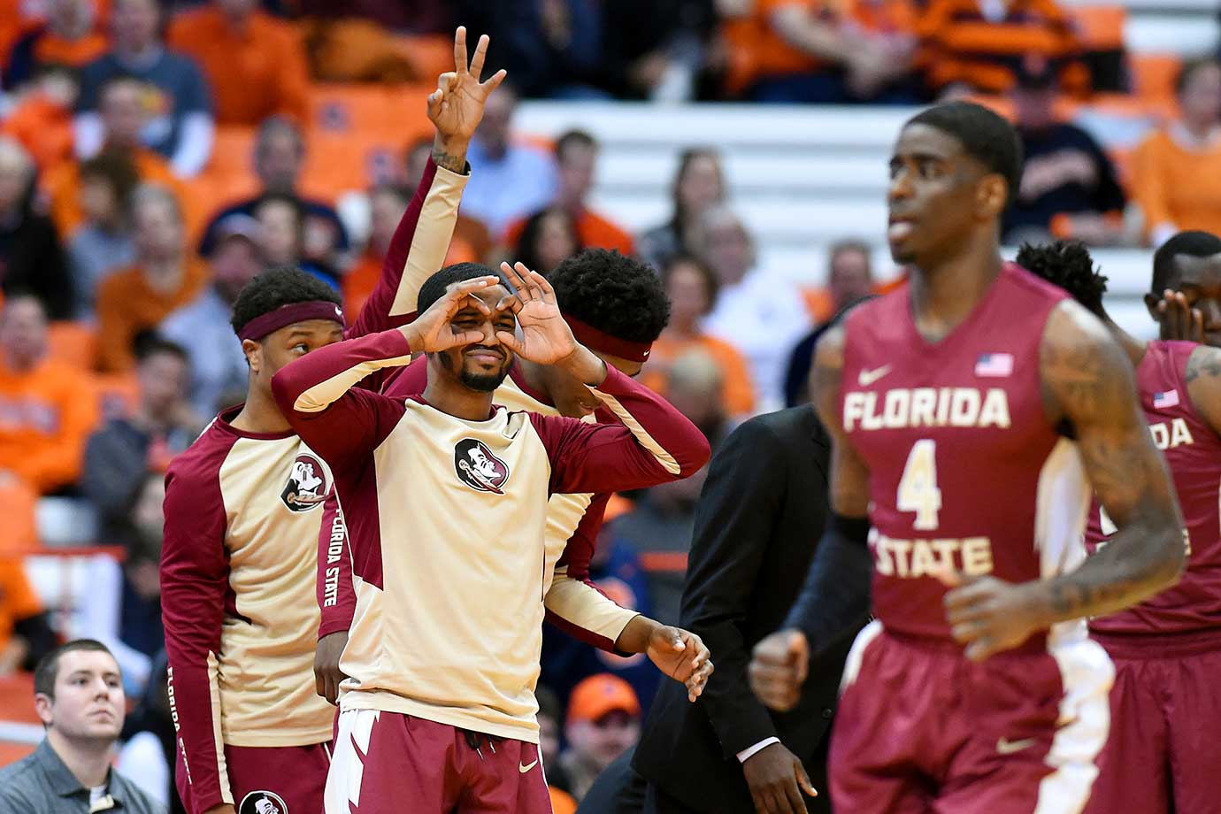 Florida State Seminoles players react from the bench to a made basket against the Syracuse Orange.