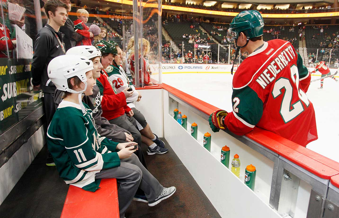Nino Niederreiter  of the Minnesota Wild talks to a group of young fans prior to the game against the Washington Capitals.