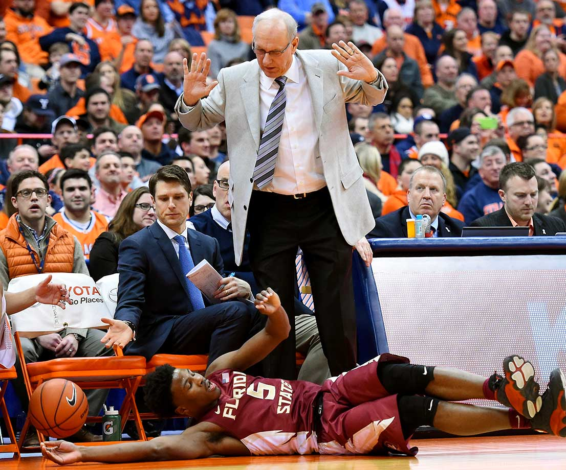 Jim Boeheim of Syracuse watches as Malik Beasley of the Florida State Seminoles dives for a loose ball at his feet.