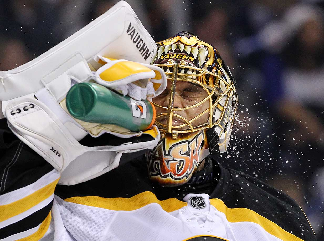 Tuuka Rask of the Boston Bruins sprays water on his face during a break in a game against Winnipeg.