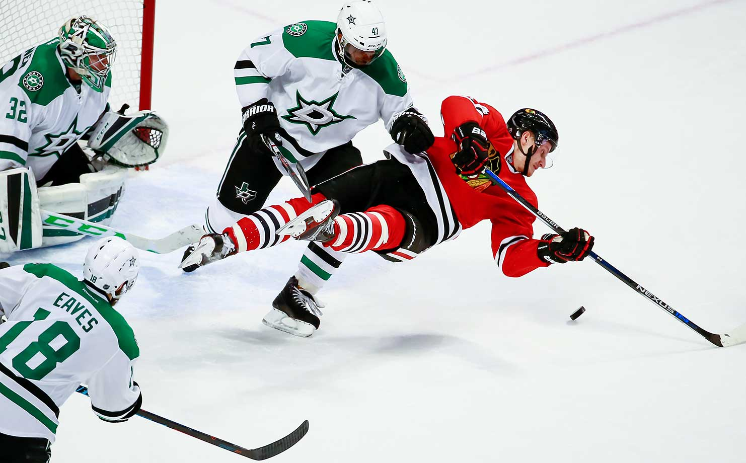 Johnny Oduya of the Dallas Stars hits Jiri Sekac of the Chicago Blackhawks.