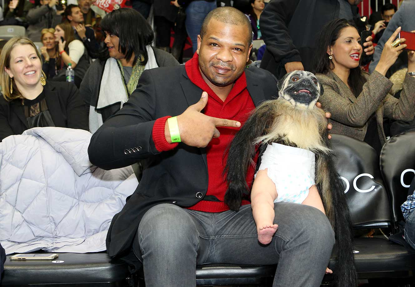 Puppy Monkey Baby sits court side during the NBA All-Star celebrity game in Toronto.