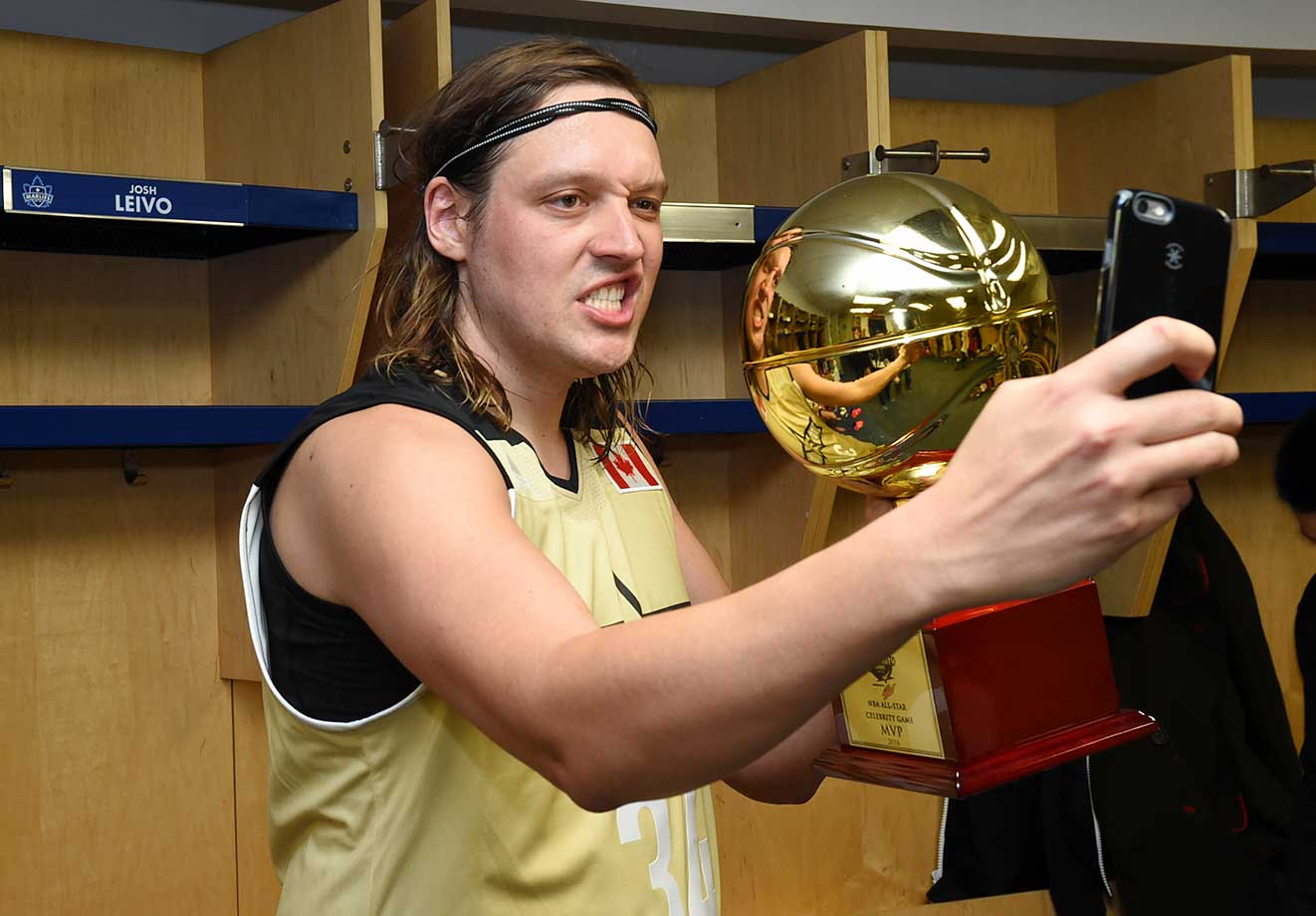 Win Butler of Team Canada poses withe MVP trophy during the NBA All-Star celebrity game.