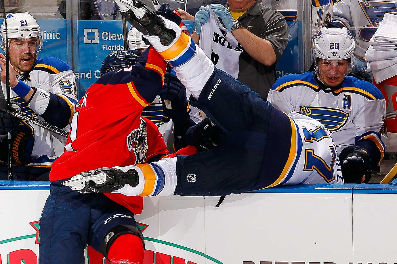 Jaden Schwartz of the St. Louis Blues gets flipped over the boards by Vincent Trocheck of the Florida Panthers.