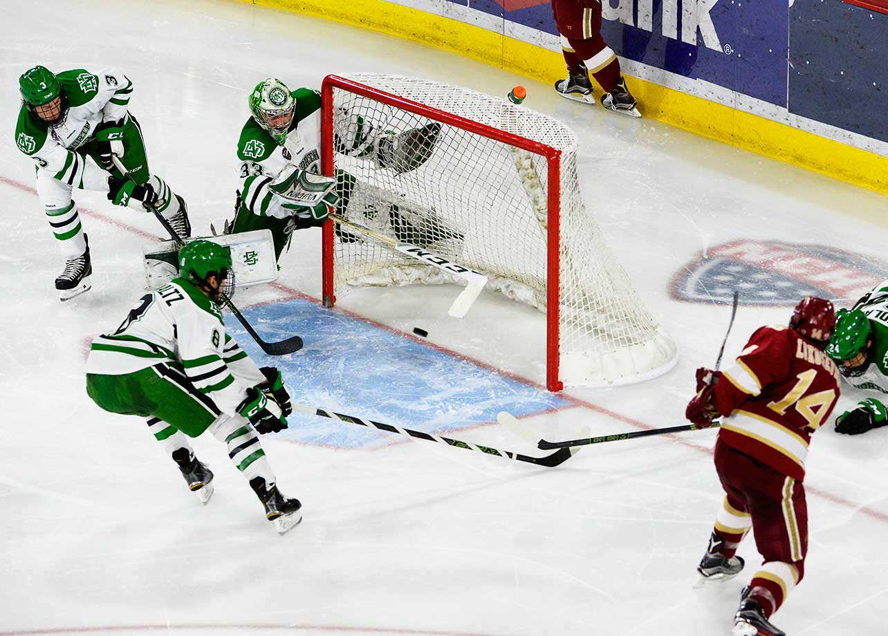 Denver Pioneers Jarid Lukosevicius catches North Dakota goalie Cam Johnson out of position, but is unable to score.