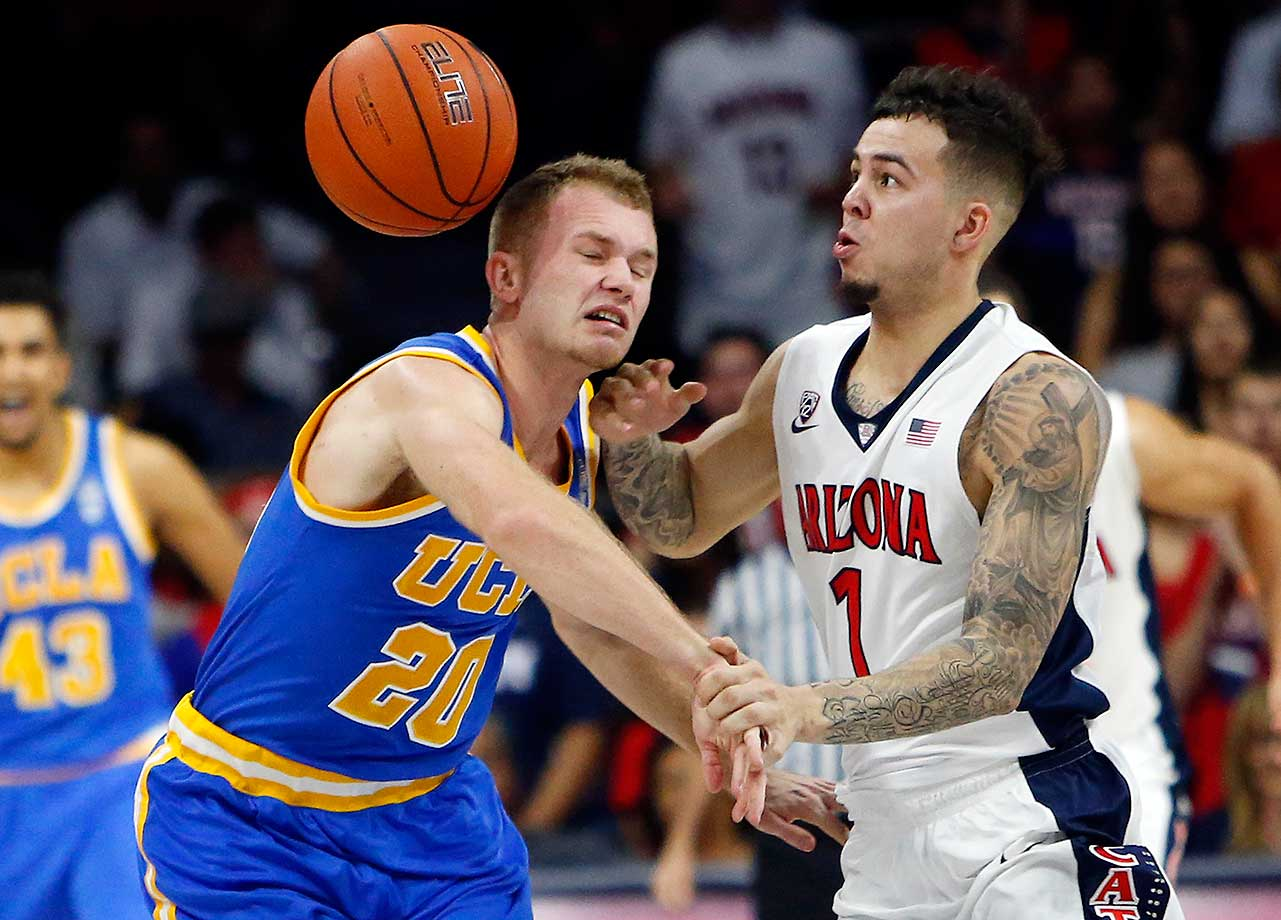 UCLA's Bryce Alford and Arizona's Gabe York vie for a loose ball.