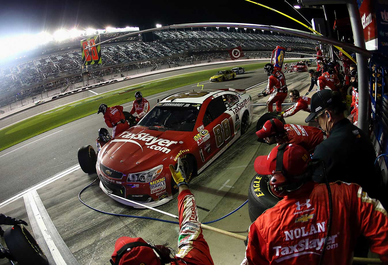 Dale Earnhardt Jr. pits during the NASCAR Sprint Cup Series Sprint Unlimited at Daytona International Speedway.