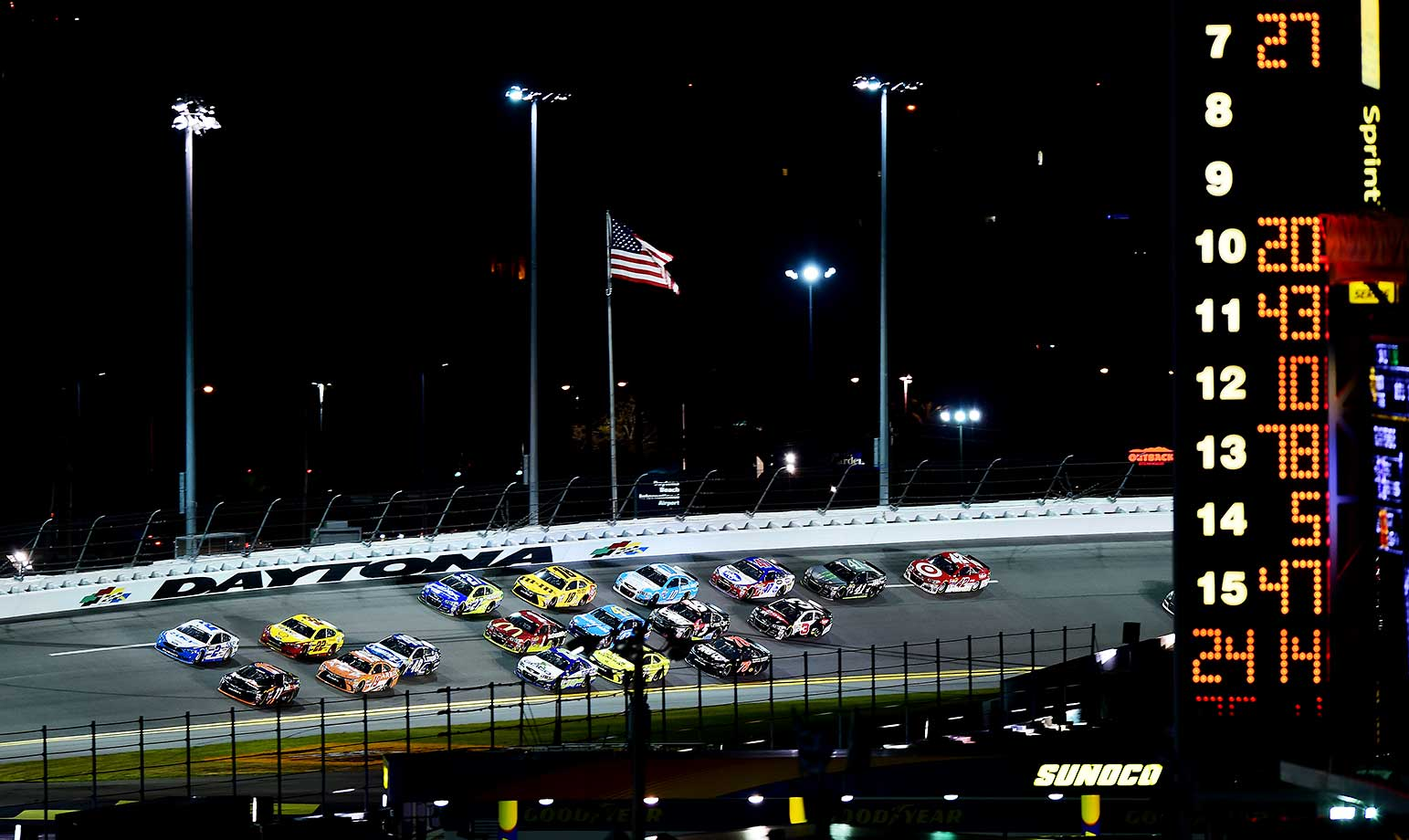 DBrad Keselowski and Denny Hamlin lead a pack of cars during the NASCAR Sprint Cup Series Sprint Unlimited at Daytona.