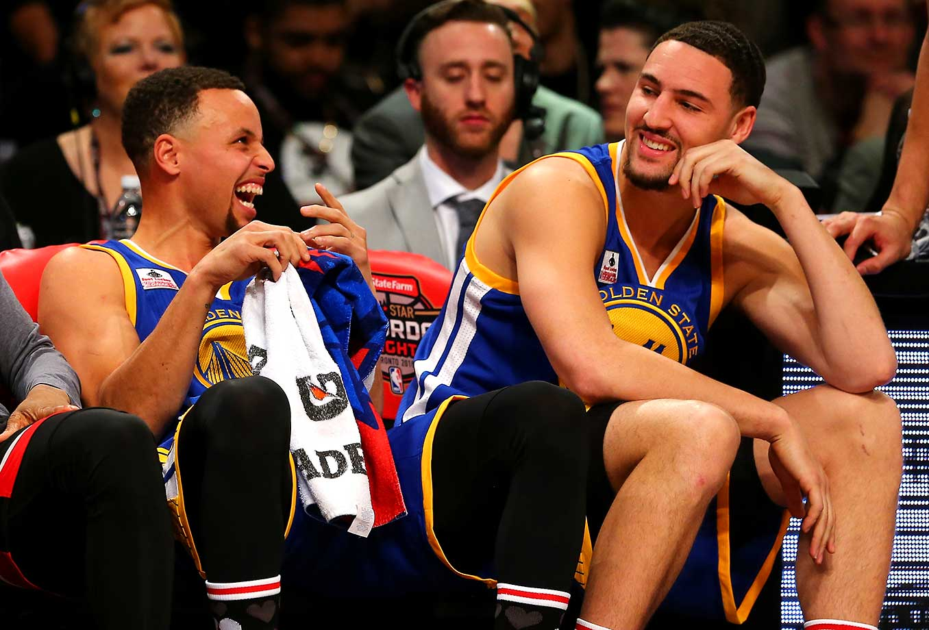 Stephen Curry and Klay Thompson laugh on the bench in the Three-Point Contest, which Thompson won.