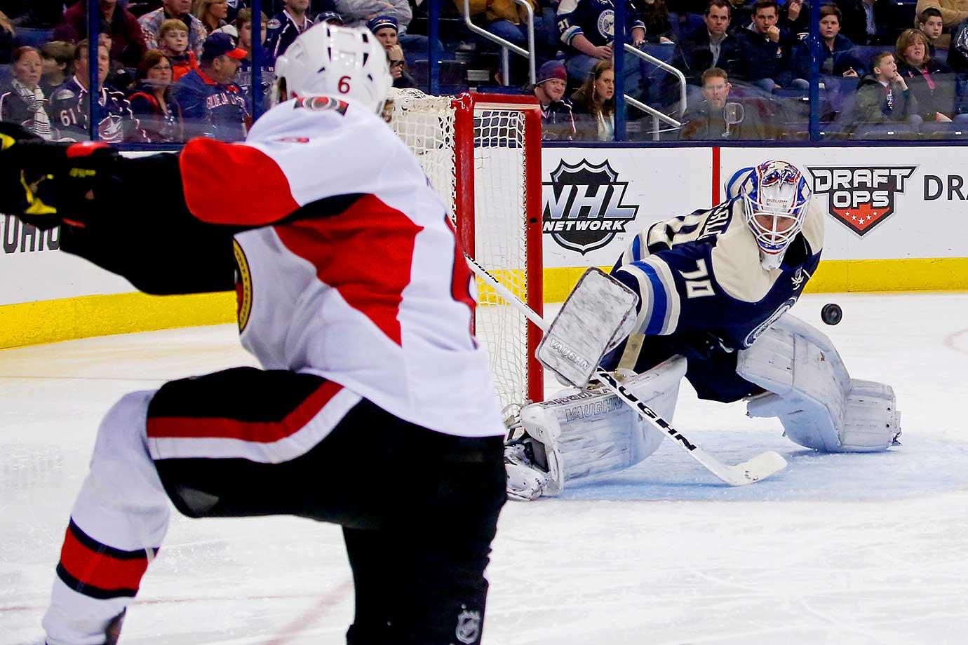 JJoonas Korpisalo of the Columbus Blue Jackets blocks a shot from Bobby Ryan of the Ottawa Senators.