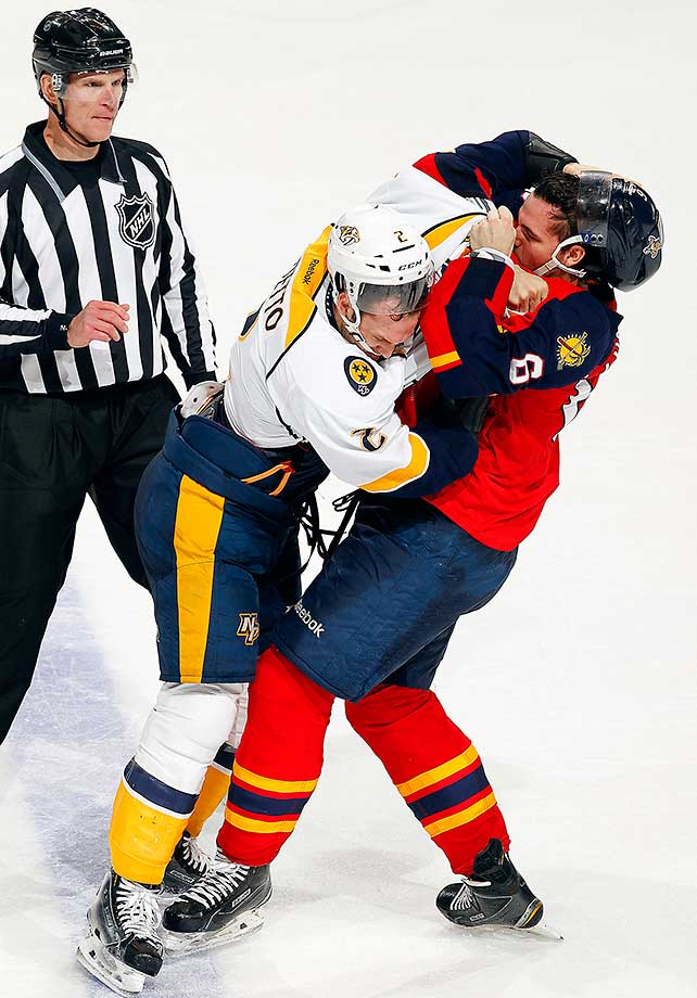 Alex Petrovic of the Florida Panthers fights with Anthony Bitetto of the Nashville Predators.