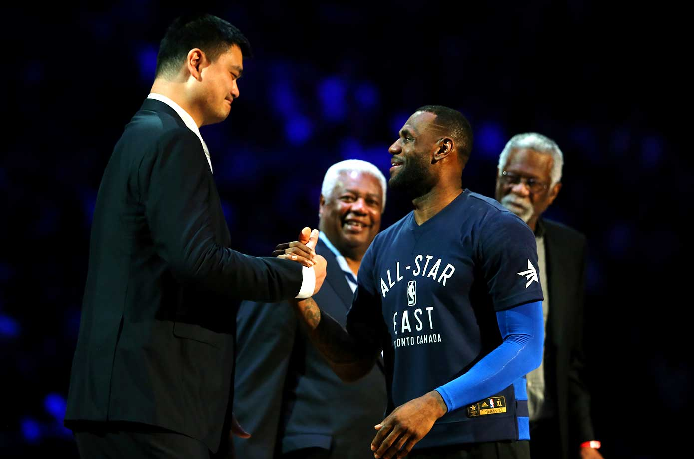 LeBron James speaks to former NBA players Yao Ming, Oscar Robertson and Bill Russell as they are honored at the NBA All-Star Game.