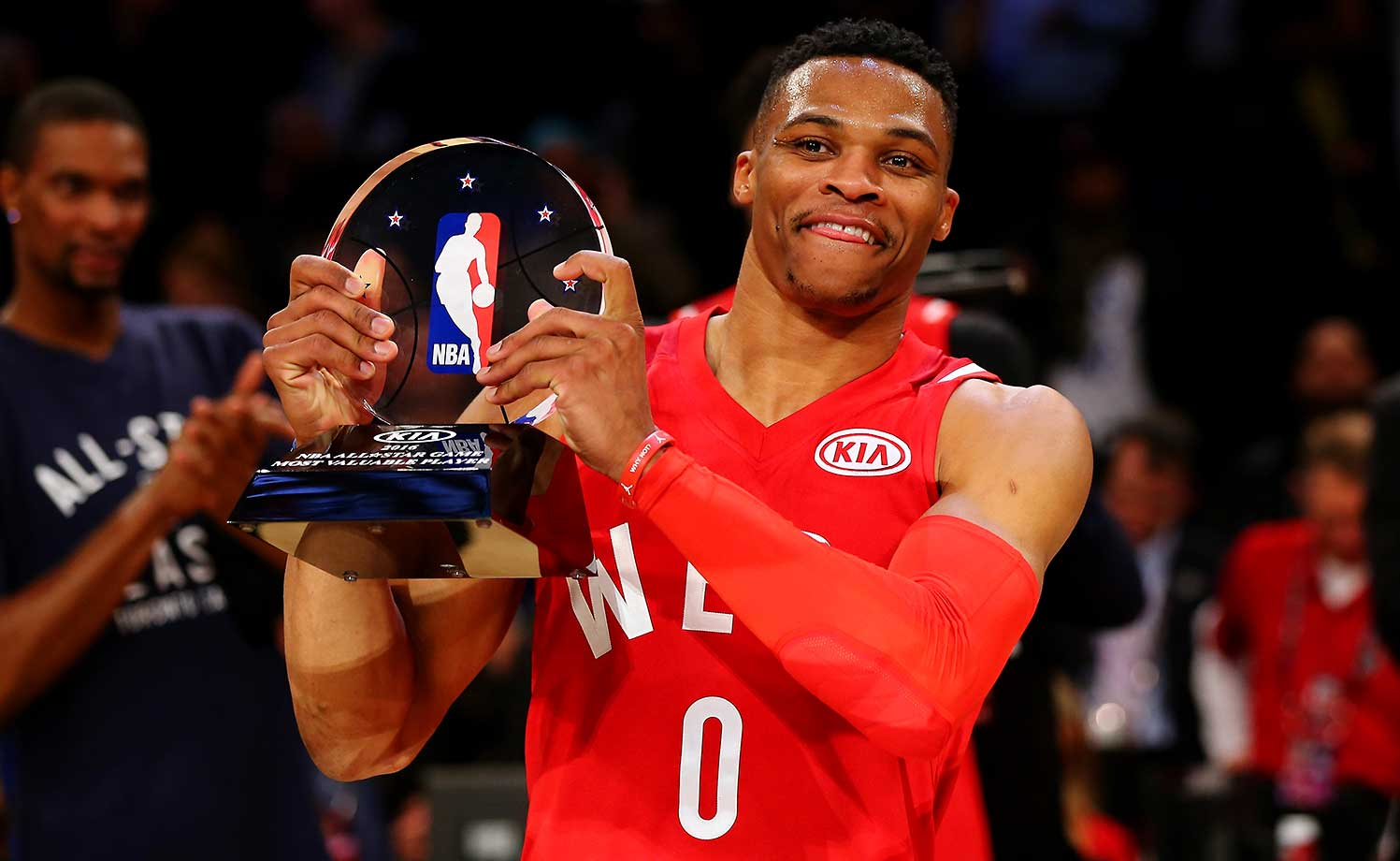 Russell Westbrook holds aloft the MVP trophy.
