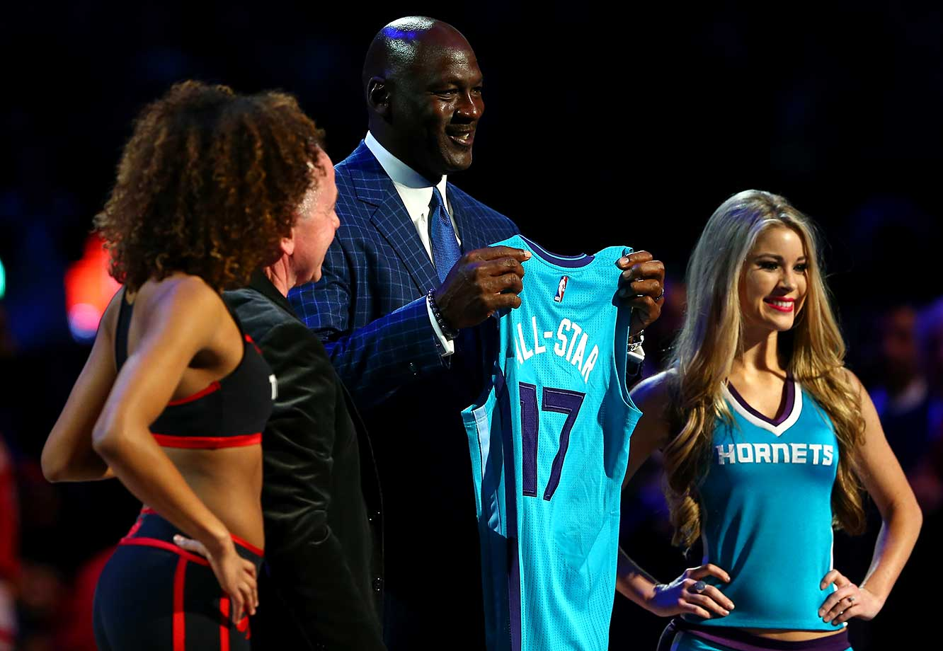 NBA Hall of Famer and Charlotte Hornets owner Michael Jordan holds a jersey signifying Charlotte as the host city for the 2017 All-Star game.