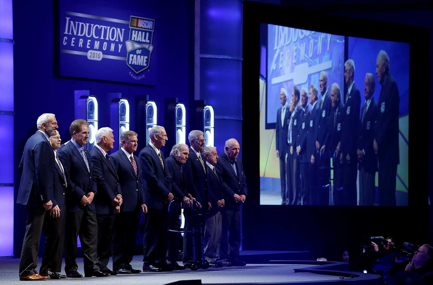The NASCAR Hall of Fame inductees from year's past join the newest inductees on stage at the Charlotte Convention Center .
