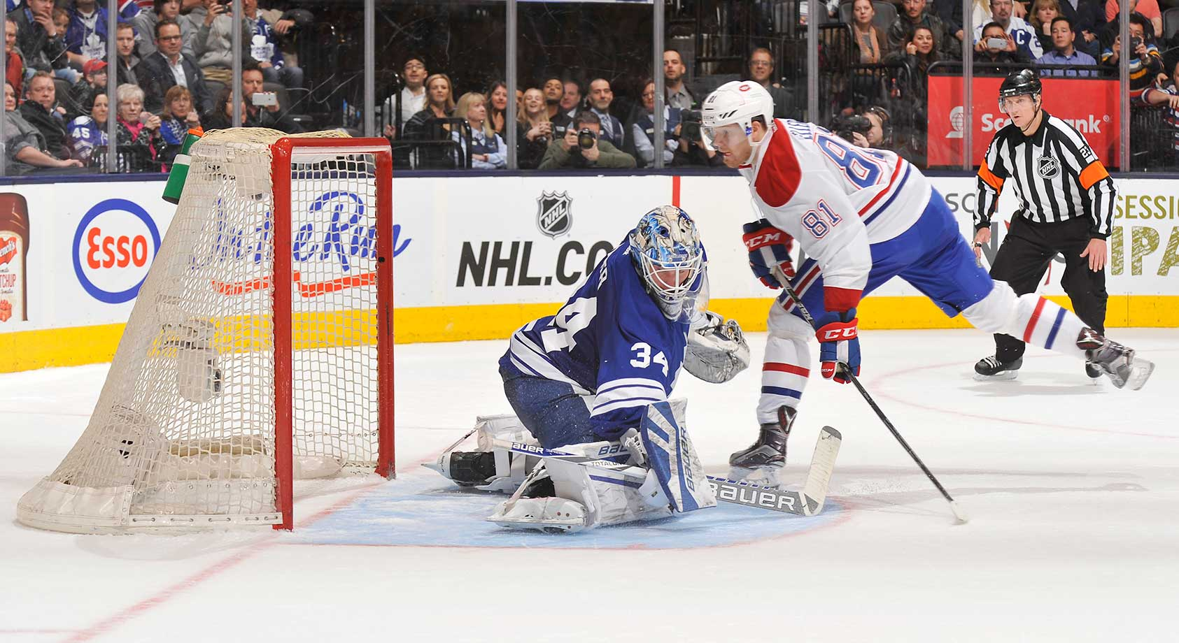 Lars Eller of the Montreal Canadiens scores the game-winning goal in the shootout on James Reimer of the Toronto Maple Leafs at Air Canada Centre in Ontario.