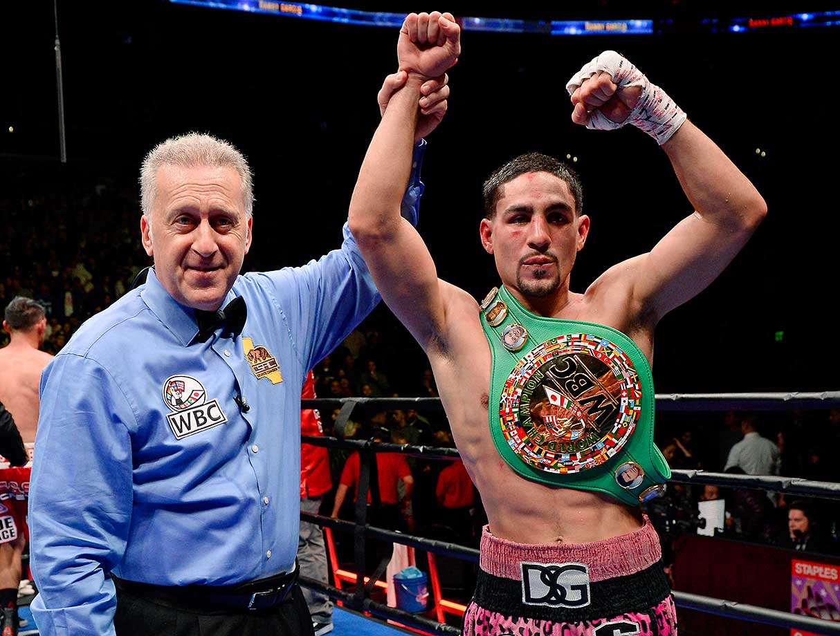 Referee Jack Reiss holds up the hand of Danny Garcia after he defeated Robert Guerrero on unanimous decision to win the WBC championship welterweight belt at Staples Center in Los Angeles.