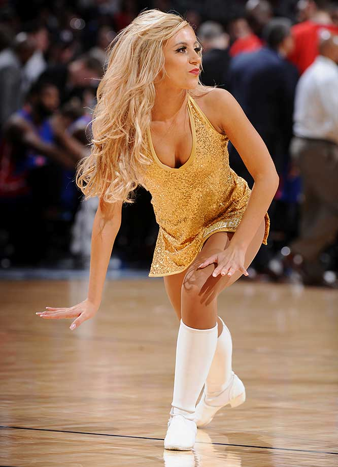 A dancer from the Denver Nuggets performs during the game against the Detroit Pistons.
