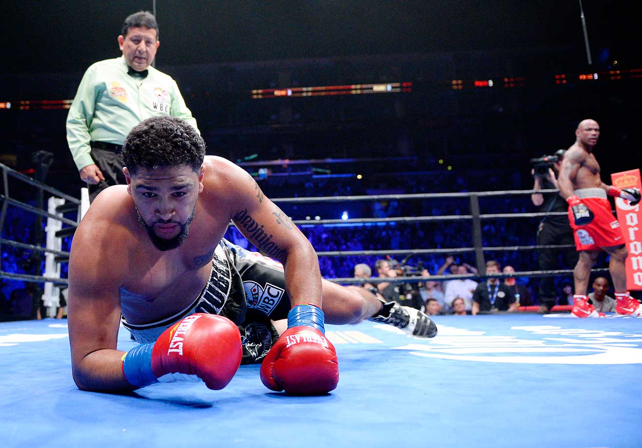 Dominic Breazeale is knocked down by Amir Mansour during the heavyweight bout at Staples Center. Breazeale survived the knockdown and defeated Mansour.