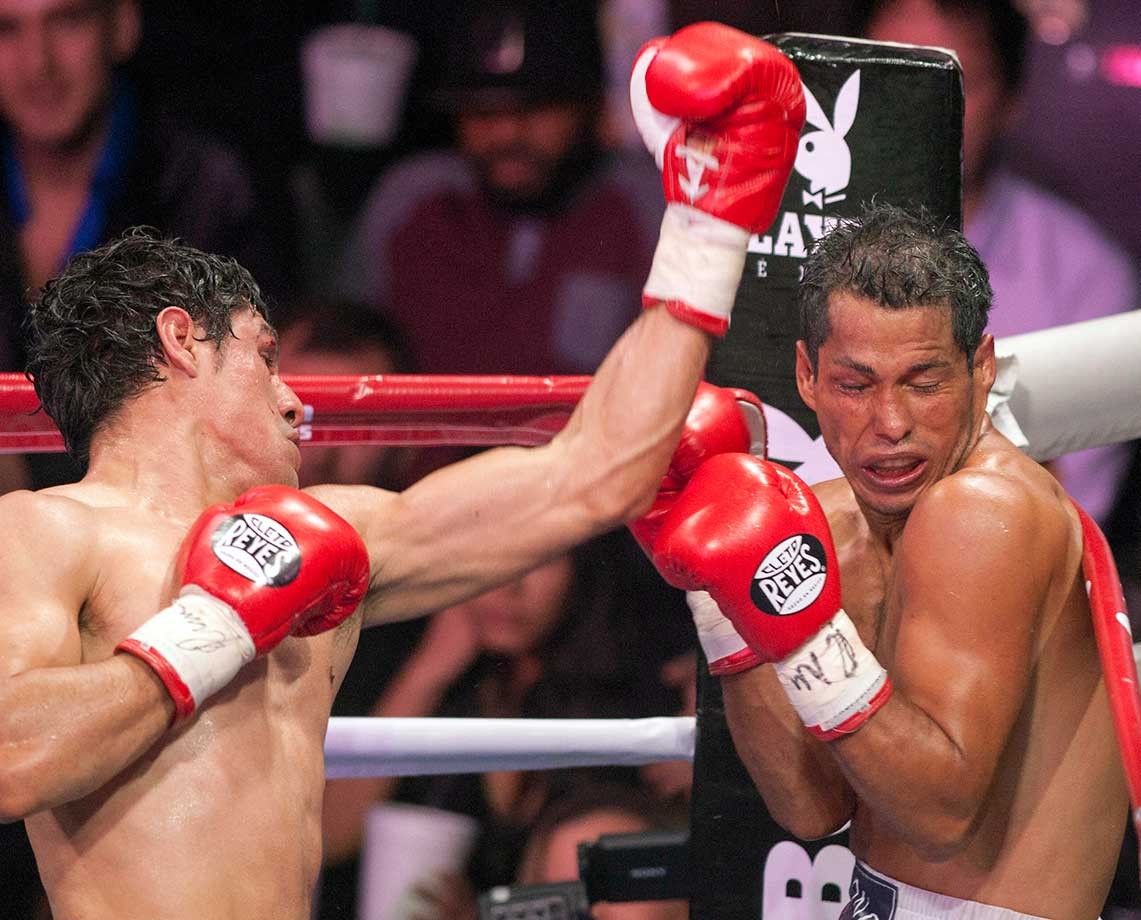 Adrian Estrella connects with a left hand against Alfonso Perez of Venezuela during their WBC lightweight boxing title fight in the Mexican city of Guadalupe.  Estrella won with a TKO in five rounds.