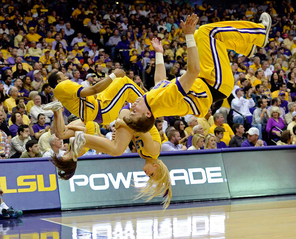 The LSU cheerleaders flip for a successful free throw in Baton Rouge, La. Oklahoma won 77-75.