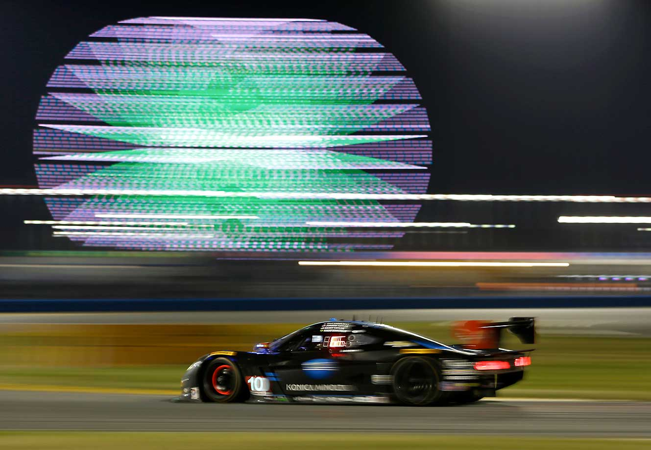 Barrichello, of Brazil, heads to the horseshoe turn during the IMSA 24-hour auto race at Daytona International Speedway.
