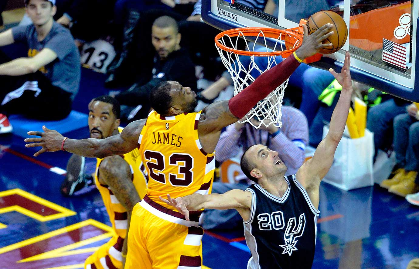 LeBron James blocks a shot attempt by San Antonio Spurs guard Manu Ginobili at Quicken Loans Arena.