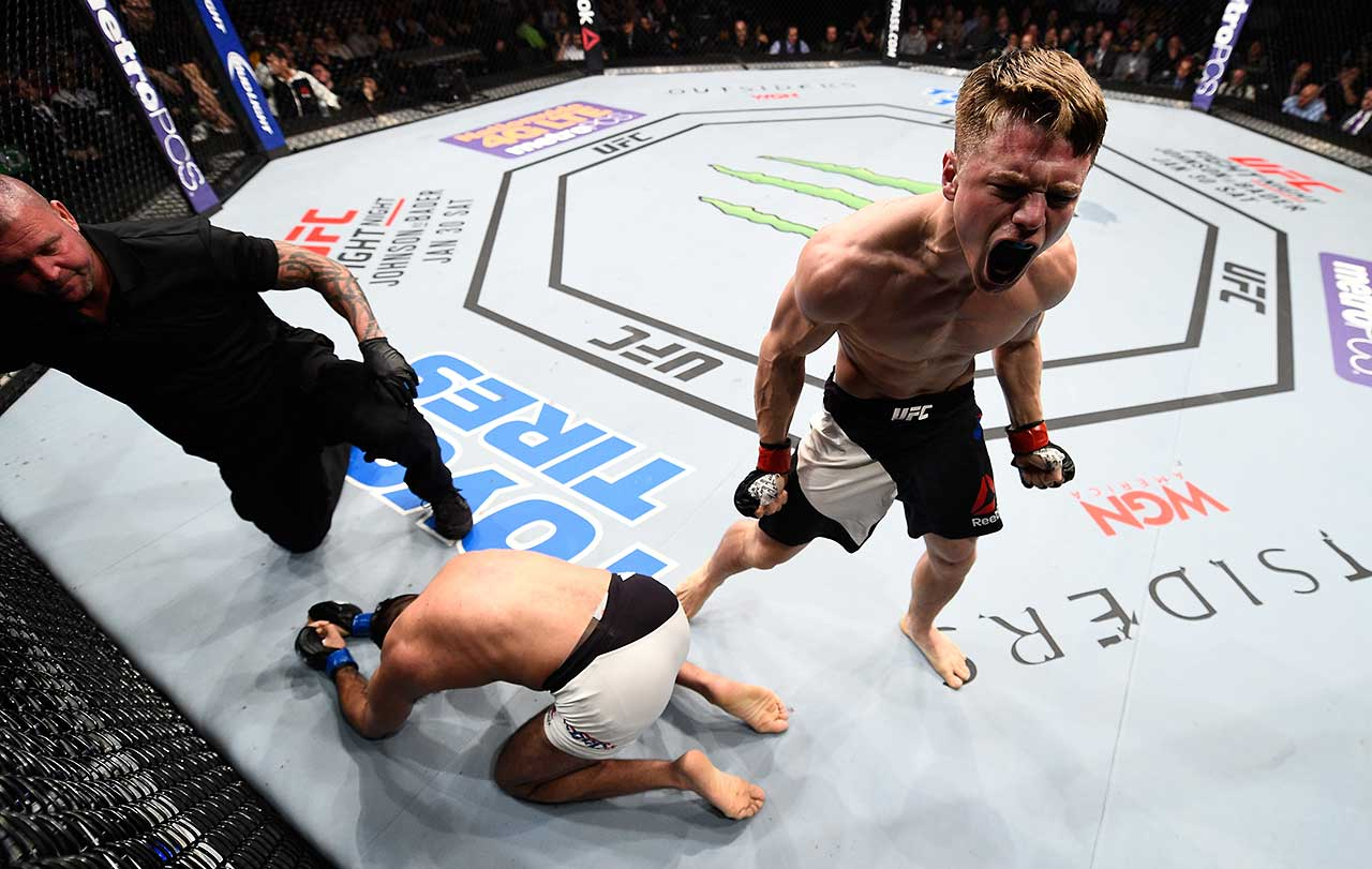 Chris Wade celebrates after his submission victory over Mehdi Bahgdad of France in their lightweight bout during the UFC Fight Night event in Boston.