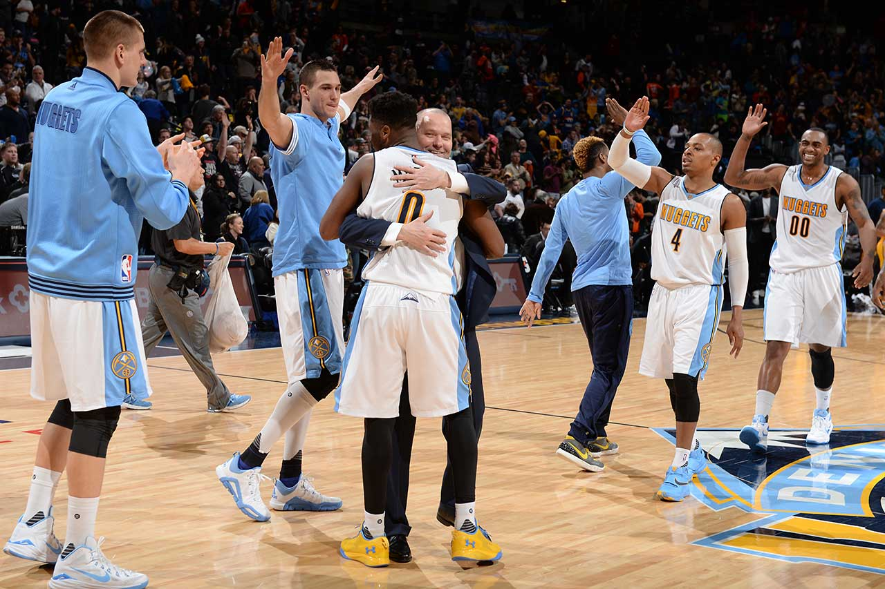 The Denver Nuggets celebrate after defeating the Indiana Pacers.