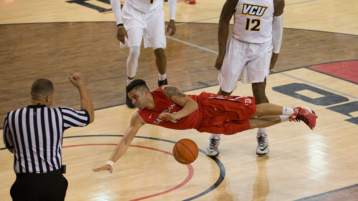 Davidson Wildcats guard Jack Gibbs goes sideways tracking after the ball while facing Virginia Commonwealth University during a game Friday in Davidson, N.C.