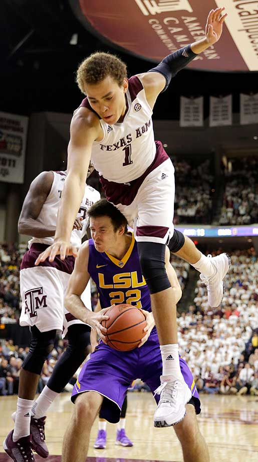 LSU's Darcy Malone is fouled by Texas A&M's DJ Hogg in College Station, Texas.