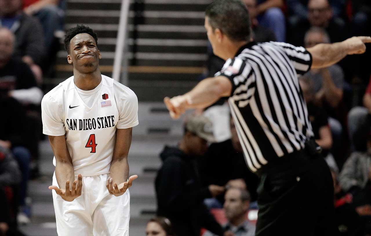 San Diego State guard Dakarai Allen reacts after picking up a foul during the first half against Fresno State in San Diego.