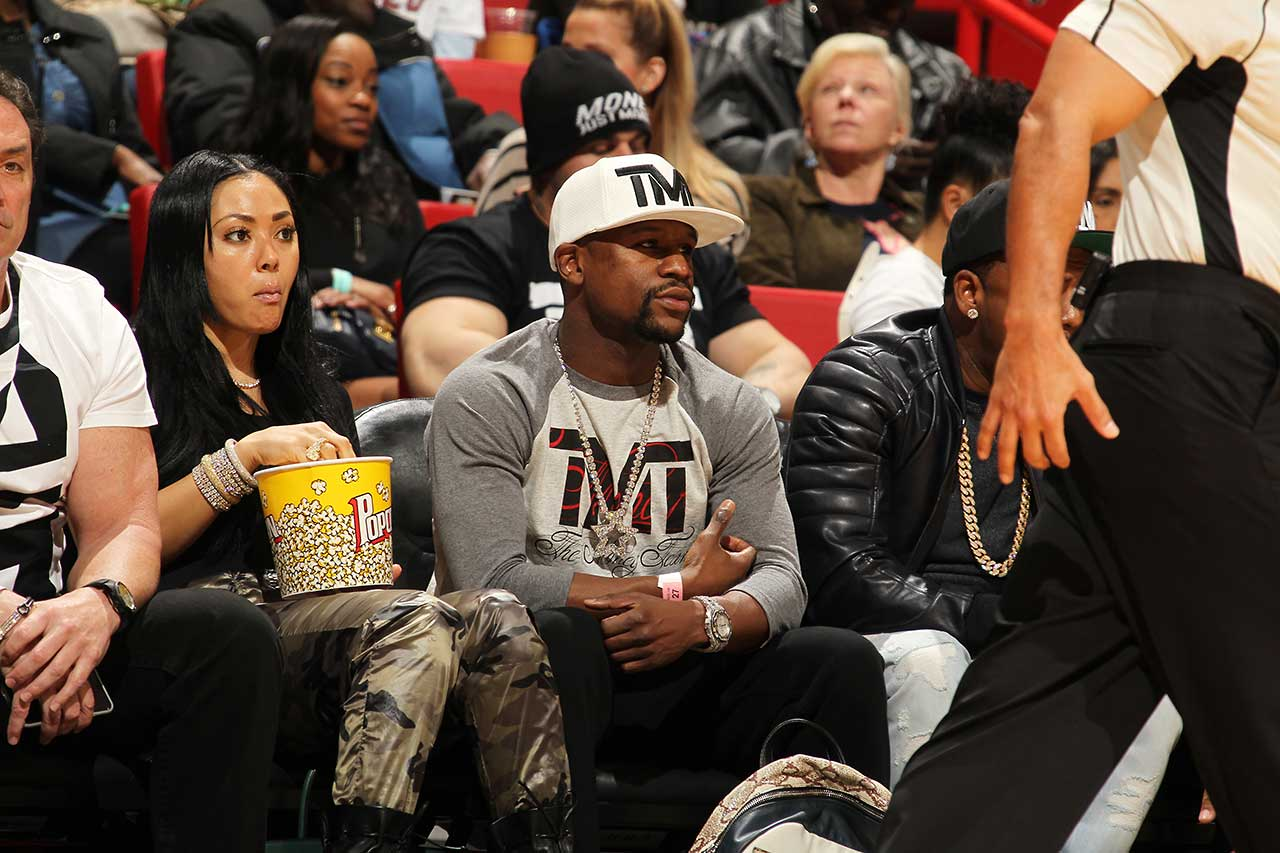 Boxer Floyd Mayweather Jr. attends the game between the Milwaukee Bucks and Miami Heat at AmericanAirlines Arena in Miami.