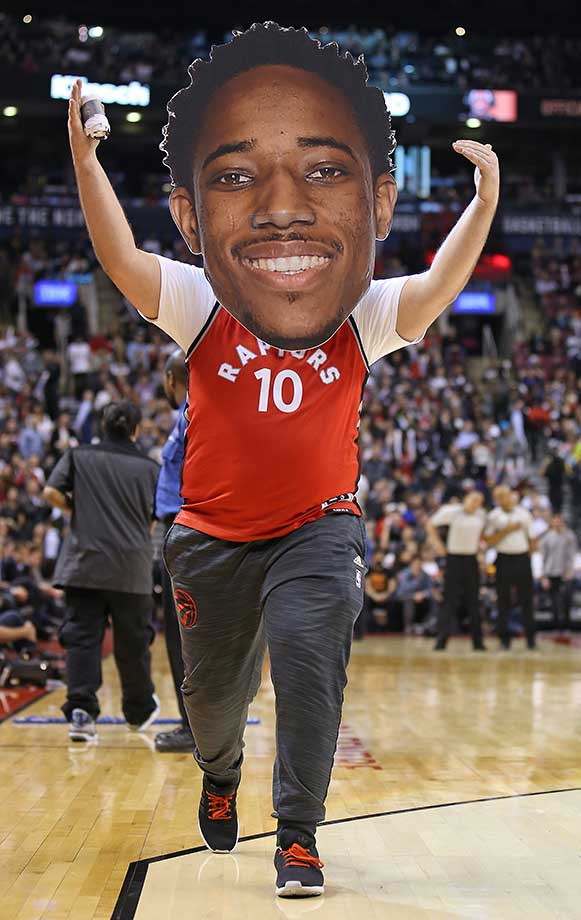 A Toronto Raptor performer sports a DeMar DeRosan cut-out face during a timeout between the Brooklyn Nets and the Raptors at the Air Canada Centre in Ontario.