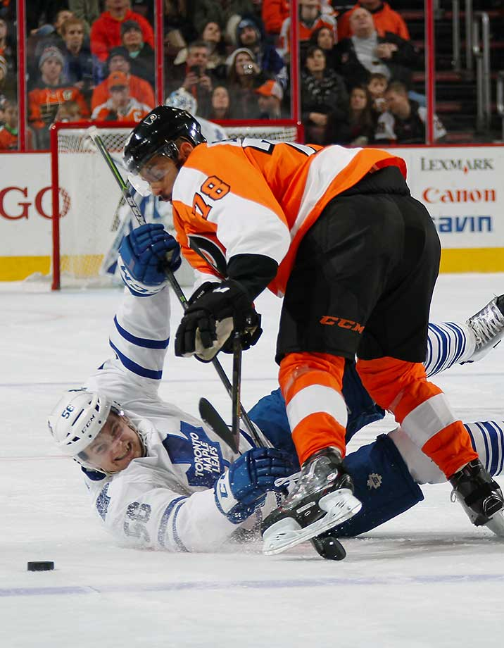 Pierre-Edouard Bellemare of the Philadelphia Flyers checks Byron Froese of the Toronto Maple Leafs at the Wells Fargo Center in Philadelphia.