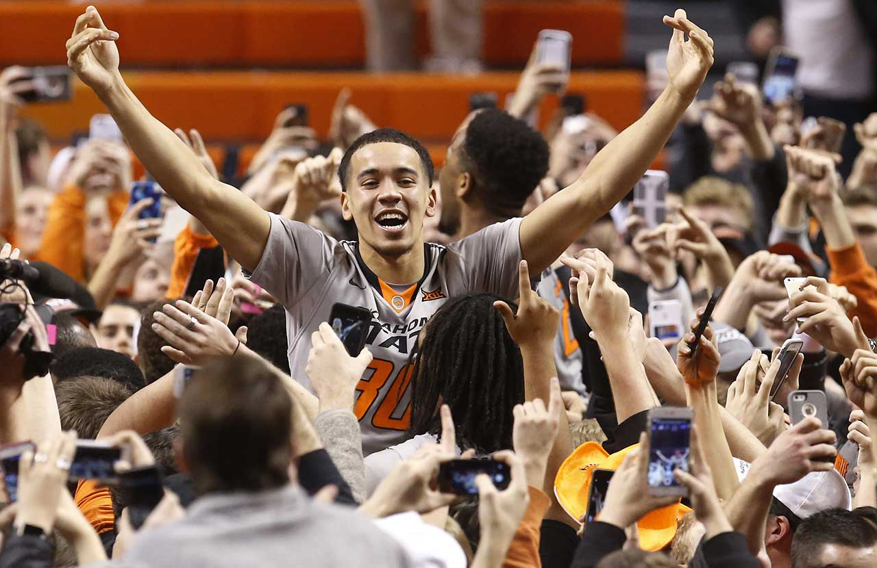 Oklahoma State guard Jeffrey Carroll celebrates with fans after Oklahoma State defeated No. 3 Kansas 86-67 in Stillwater, Okla.