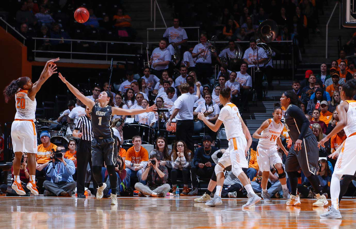 Te'a Cooper of the Tennessee Lady Volunteers shoots the long ball over Rebekah Dahlman of the Vanderbilt Commodores  at Thompson-Boling Arena in Knoxville.