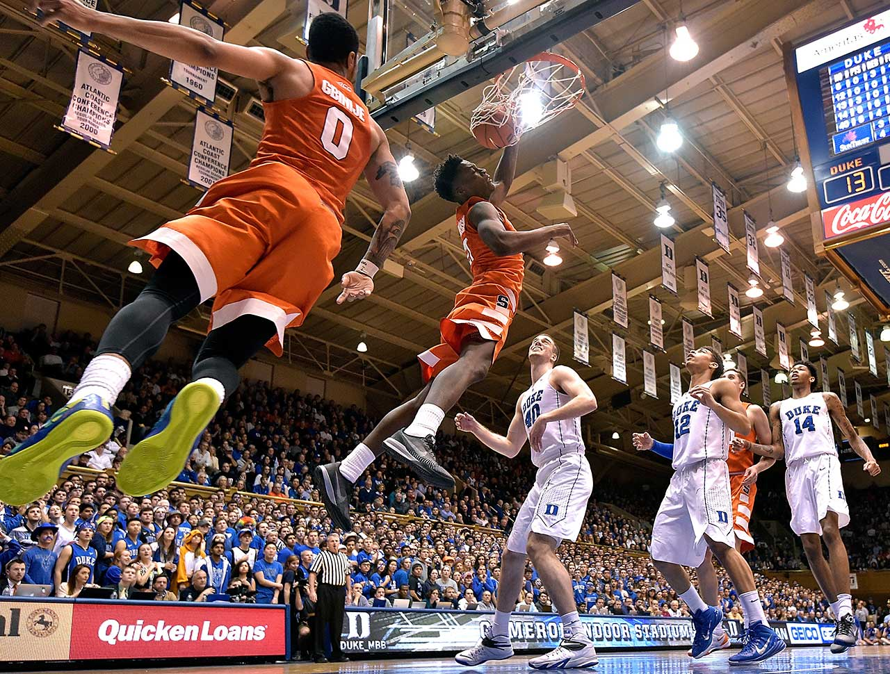 Tyler Roberson of the Syracuse Orange dunks over Marshall Plumlee of Duke.