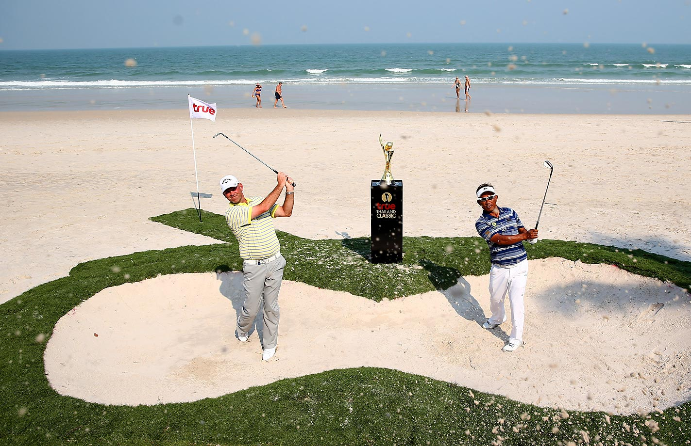 Thomas Bjorn of Denmark and Thongchai Jaidee of Thailand pose for the media to promote the Thailand Classic golf event on the beach outside the Intercontinental Hua Hin Resort in Thailand.
