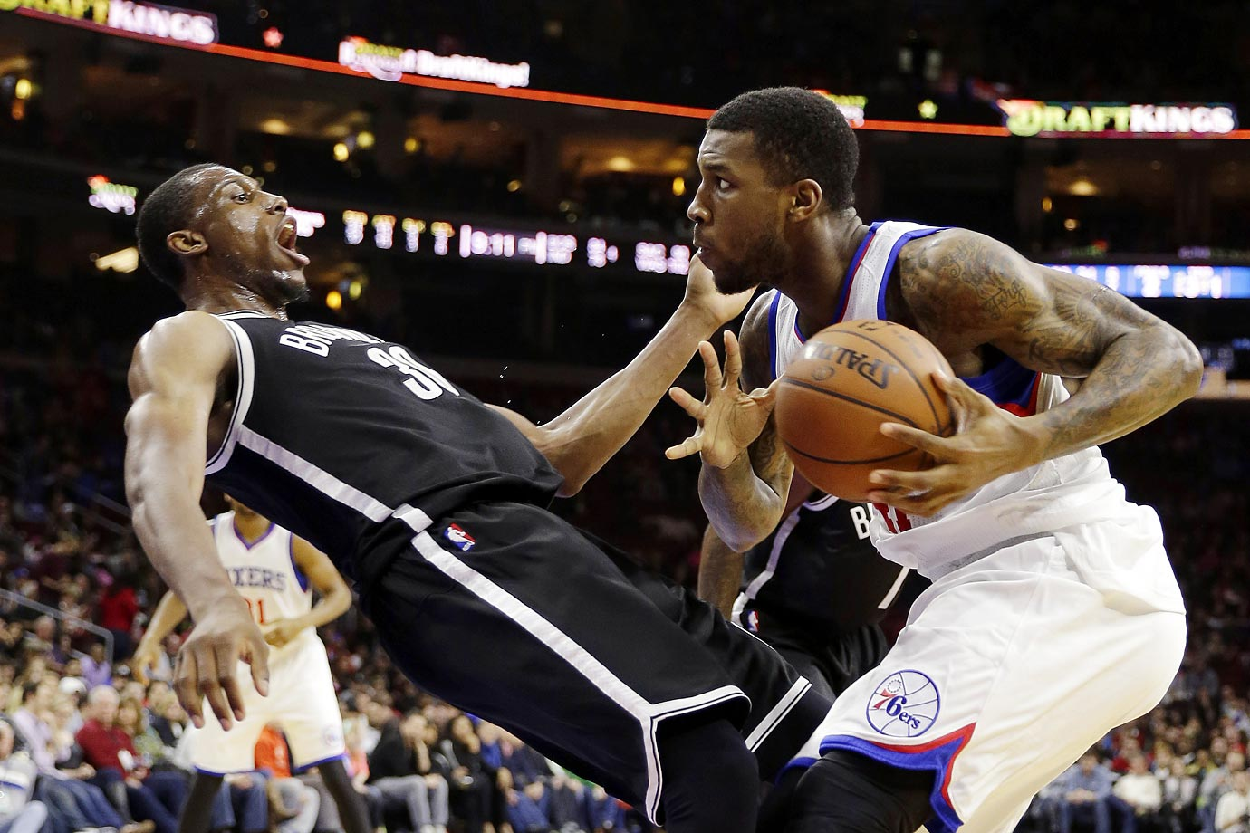 Thomas Robinson of the 76ers collides with Brooklyn Nets' Thaddeus Young. Brooklyn won 94-87.