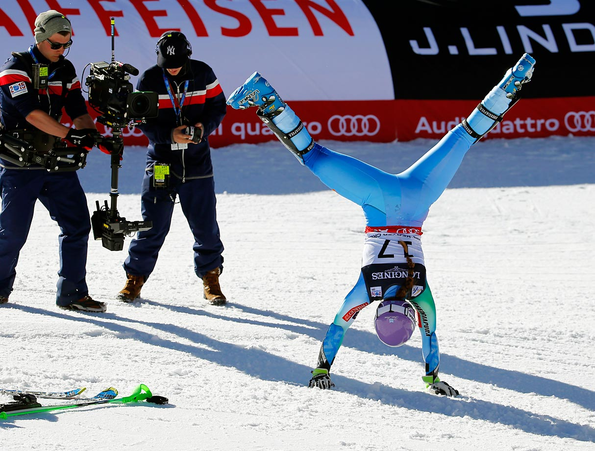Slovenia's Tina Maze does a cartwheel after finishing her run during the alpine slalom competition in Beaver Creek, Colo.