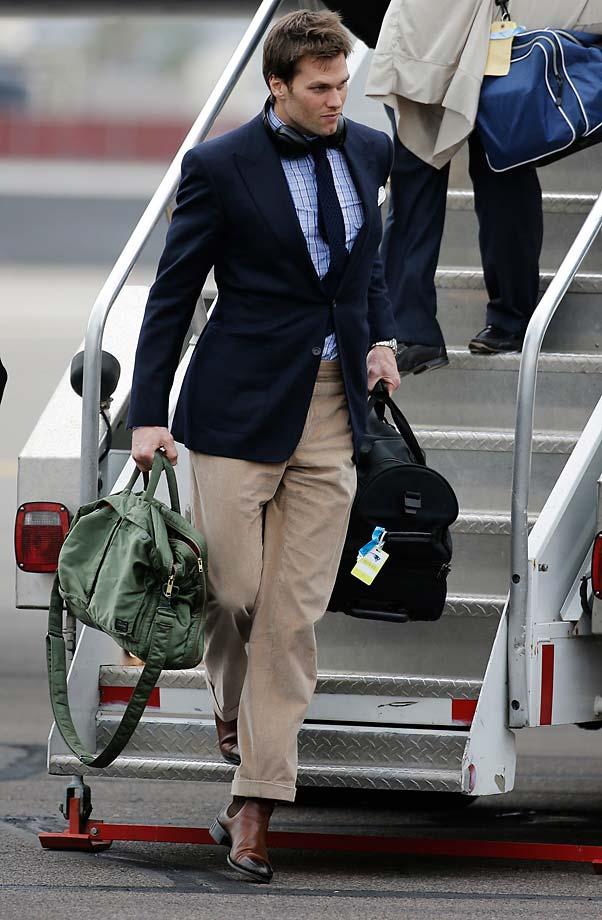 Patriots quarterback Tom Brady steps off the plane in Arizona.