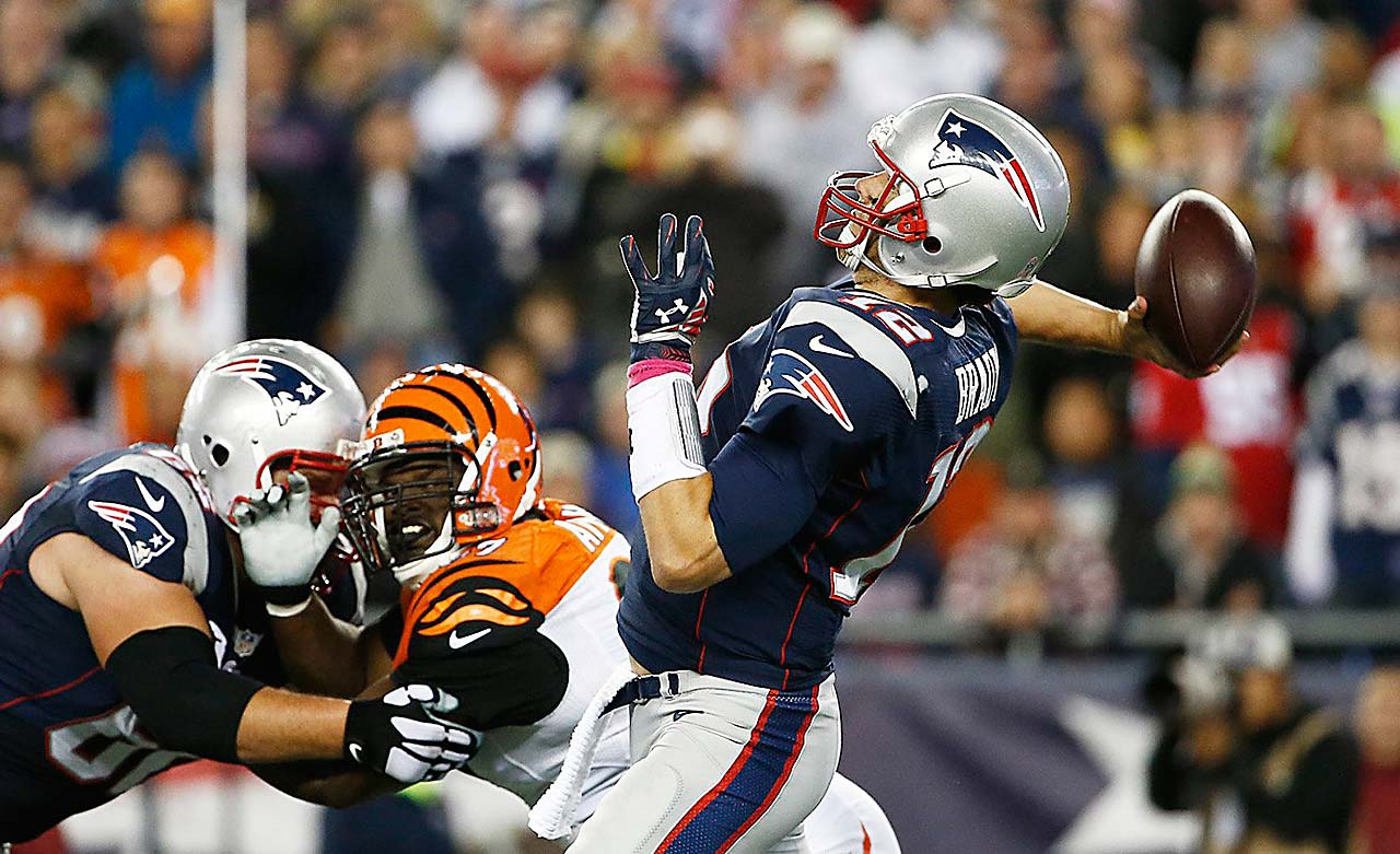 Tom Brady launches a pass on the night he became the sixth NFL quarterback to surpass 50,000 career passing yards.