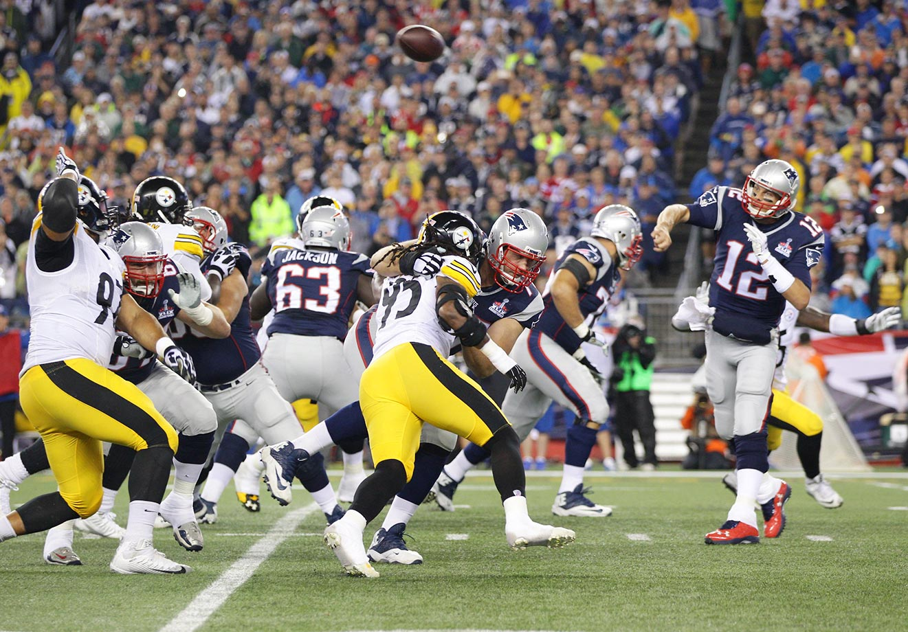 Tom Brady passes behind blocking by (from left) LG Josh Kline (67), C David Andrews (60), RG Tre' Jackson, LT Nate Solder (77) and RT Sebastian Vollmer (76).