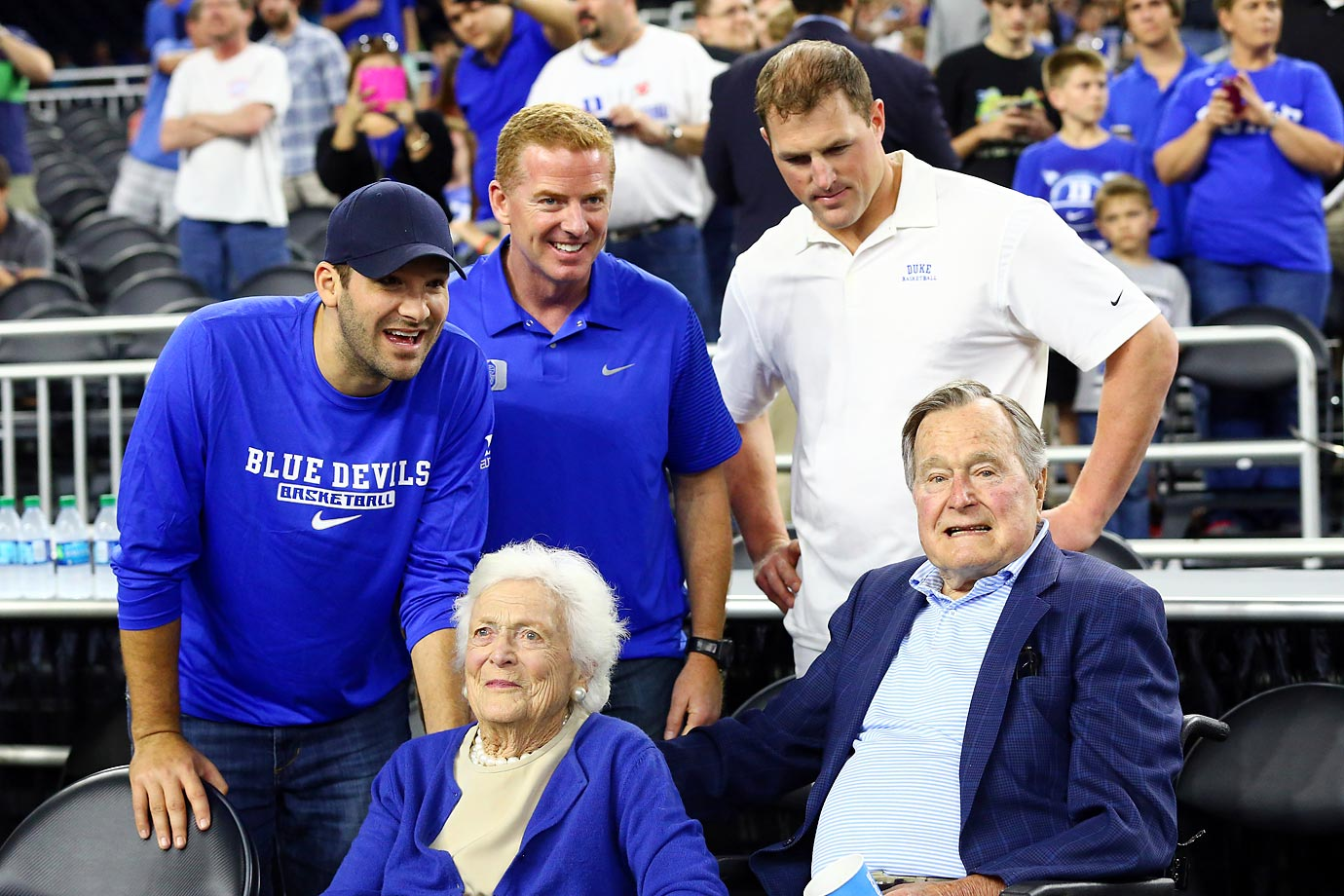 Tony Romo, Jason Garrett and Jason Witten of the Cowboys take in the Duke-Gonzaga game with former First Lady Barbara Bush and former President H.W. Bush.
