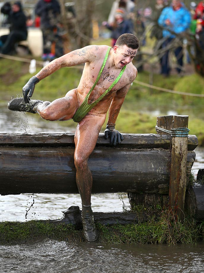 A competitor wears a mankini in the Tough Guy Challenge at South Perton Farm, England.