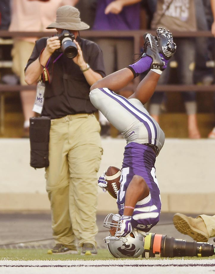 Kansas State's Tyler Lockett flips out of bounds in game against Auburn.