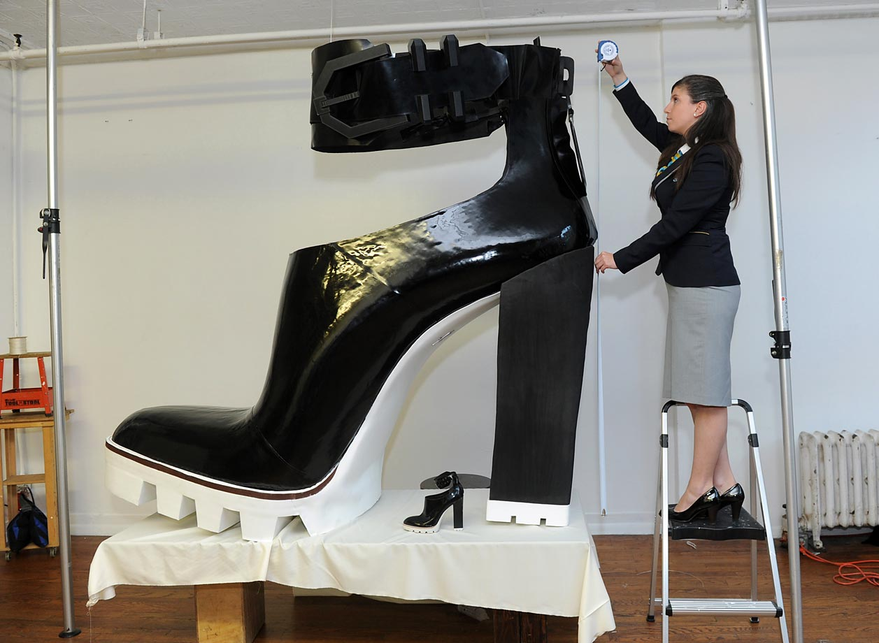 The largest high-heeled shoe measures 1.95 m (6 ft., 5 inches) long and 1.85 m (6 ft, 1 inch) tall and was created by Jill Martin and Kenneth Cole in New York in celebration of Guinness World Records Day 2014.